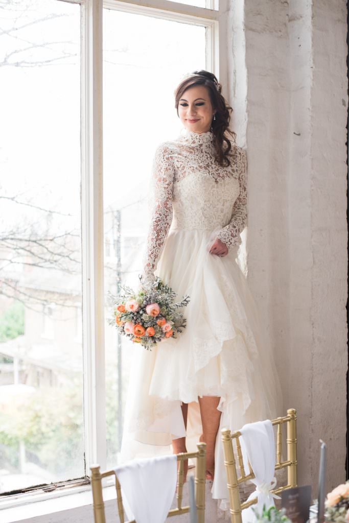 bride wearing english wedding dress for daytime wedding