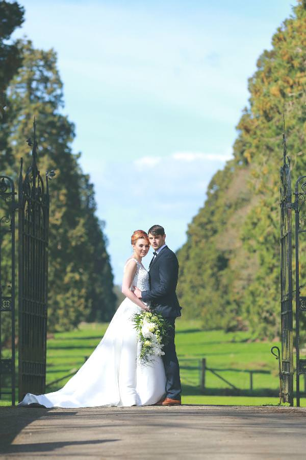 bride and groom on the beautiful grounds of the Elvetham hotel