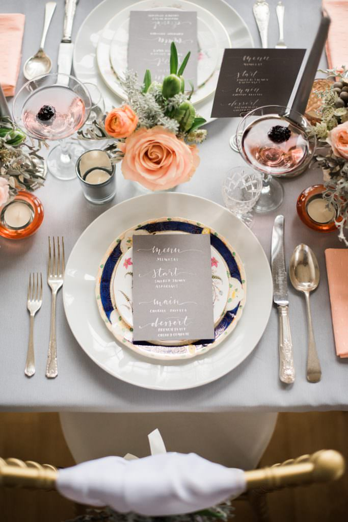wedding reception tablescape with peach and grey tones.