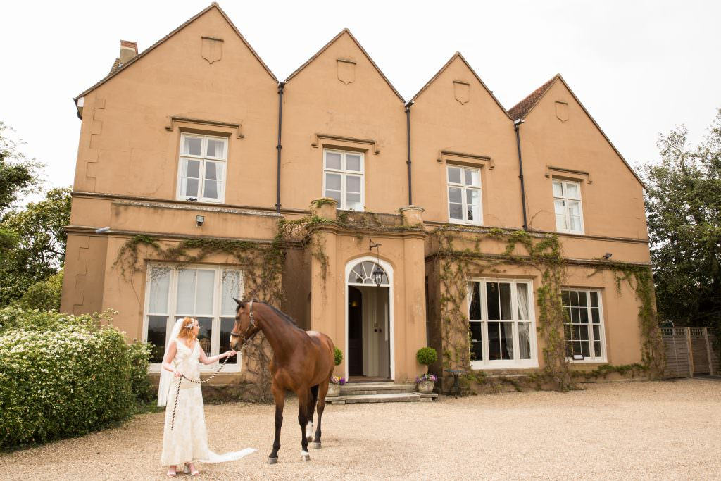 bride with horse in front of Nurstead Court