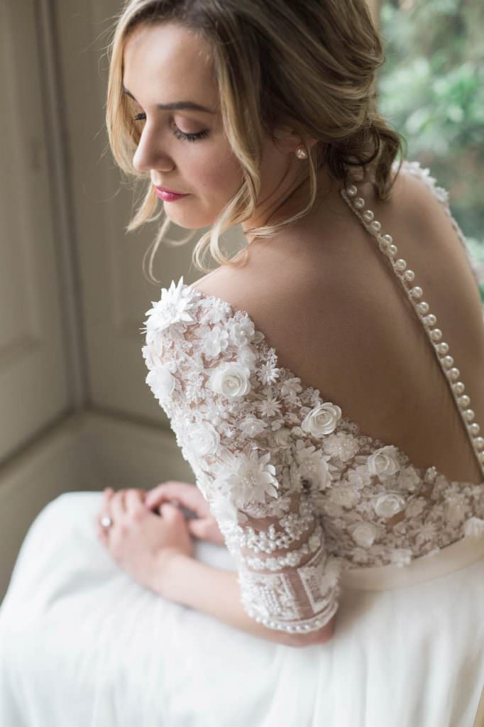 sheer back of bride's wedding dress floral details