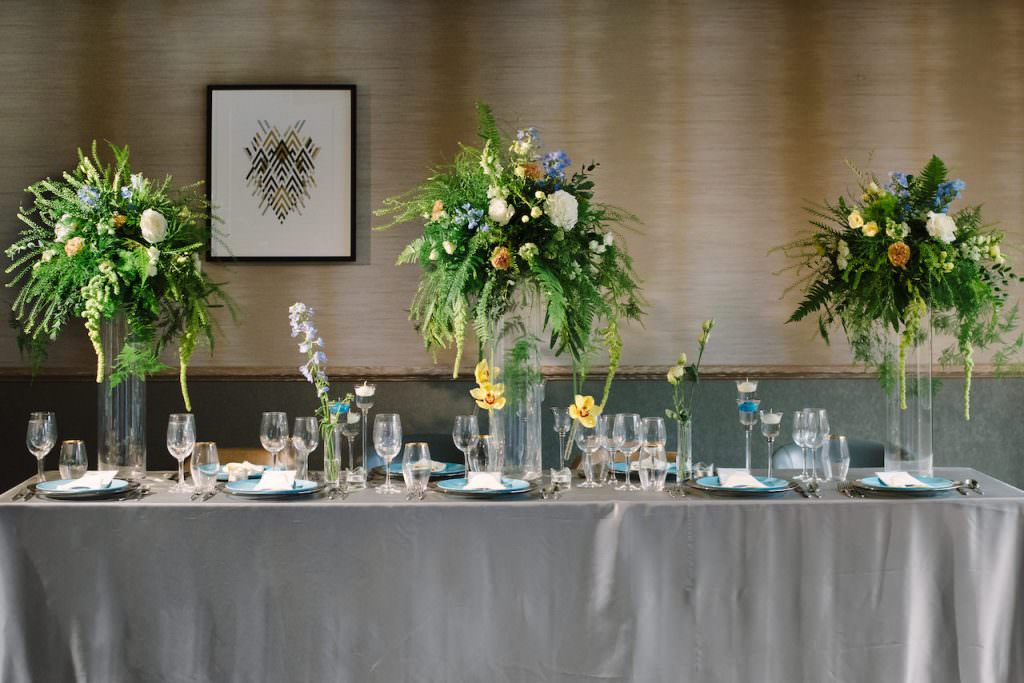 nature inspired wedding reception tablescape with hints of blue at hotel wedding venue surrey