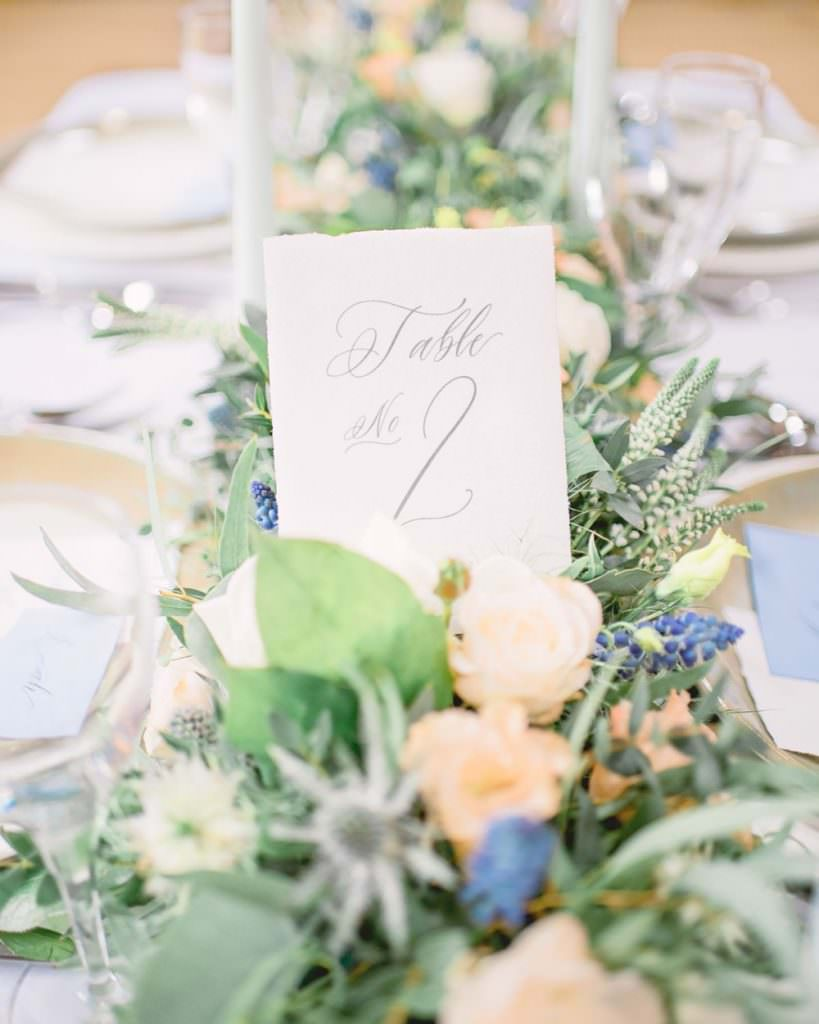floral runner with table number in calligraphy