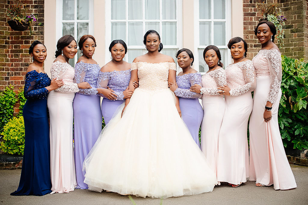 bride with her bridesmaids part of wedding traditions