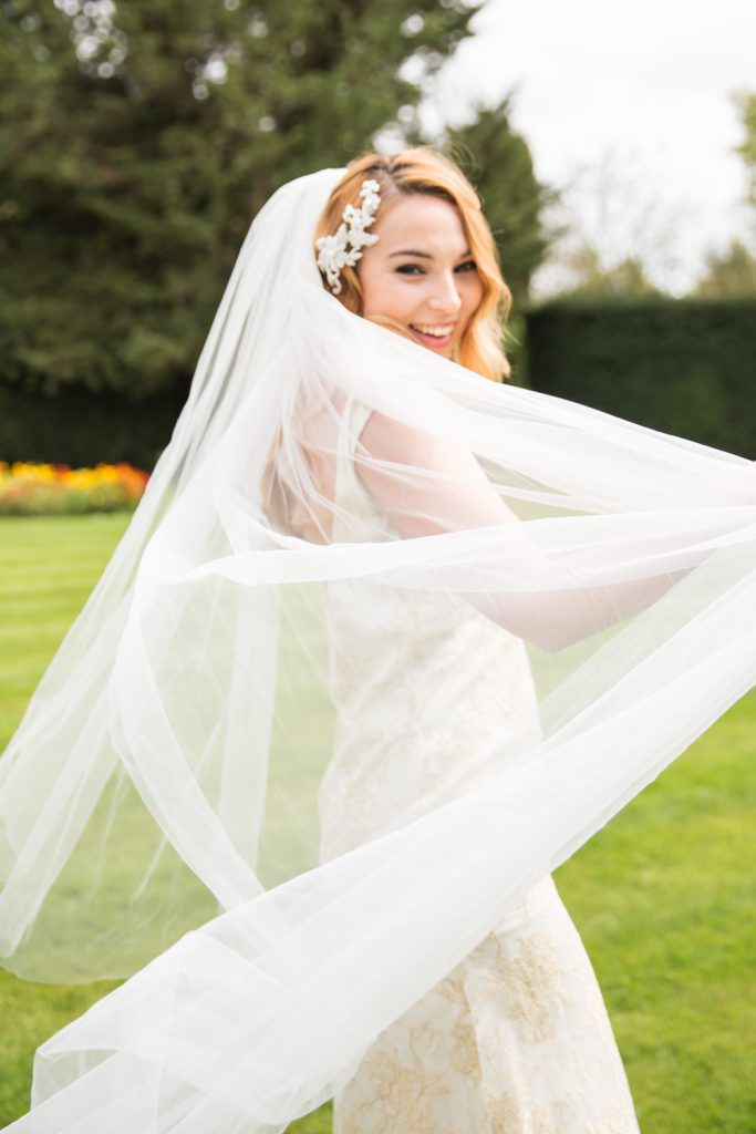 bride wearing a veil part of wedding traditions we practice today
