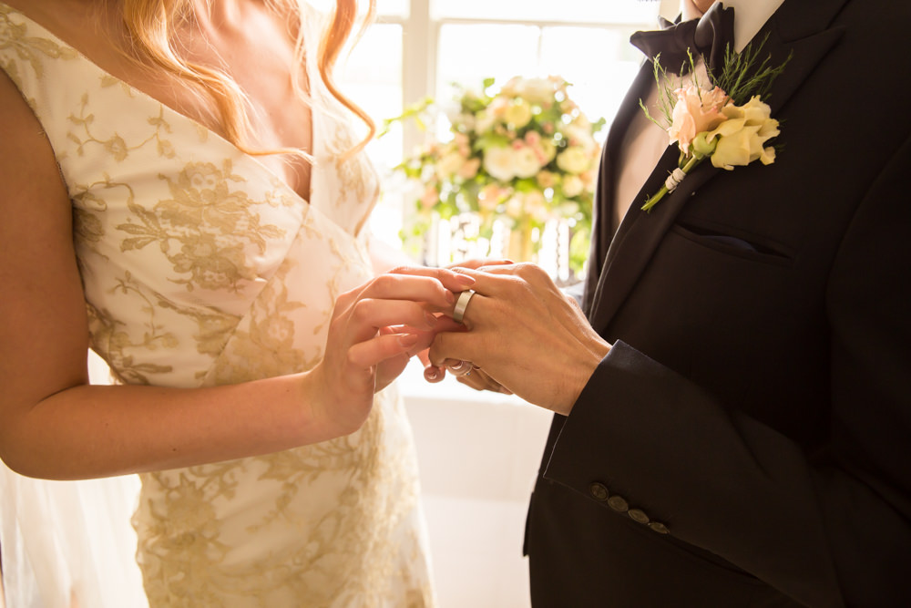 bride and groom exchanging wedding rings part of wedding traditions