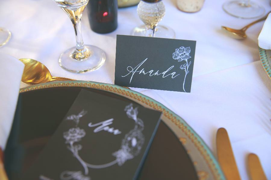 black and white place card at wedding reception