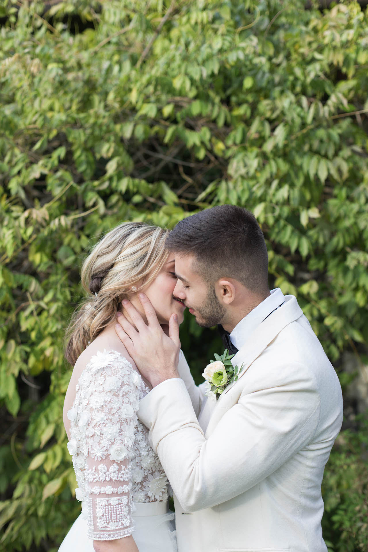 bride and groom about to kiss after wedding ceremony