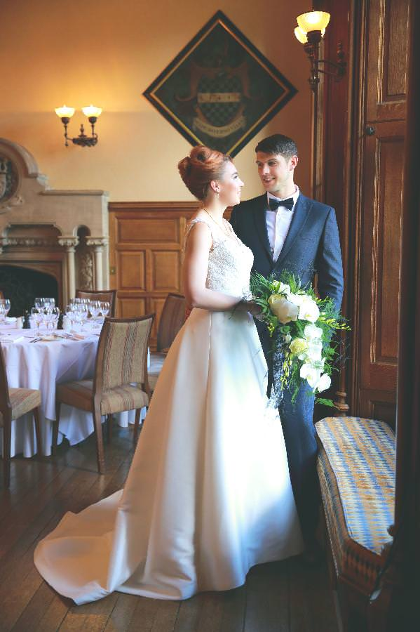 bride and groom at wedding reception at the Elvetham hotel