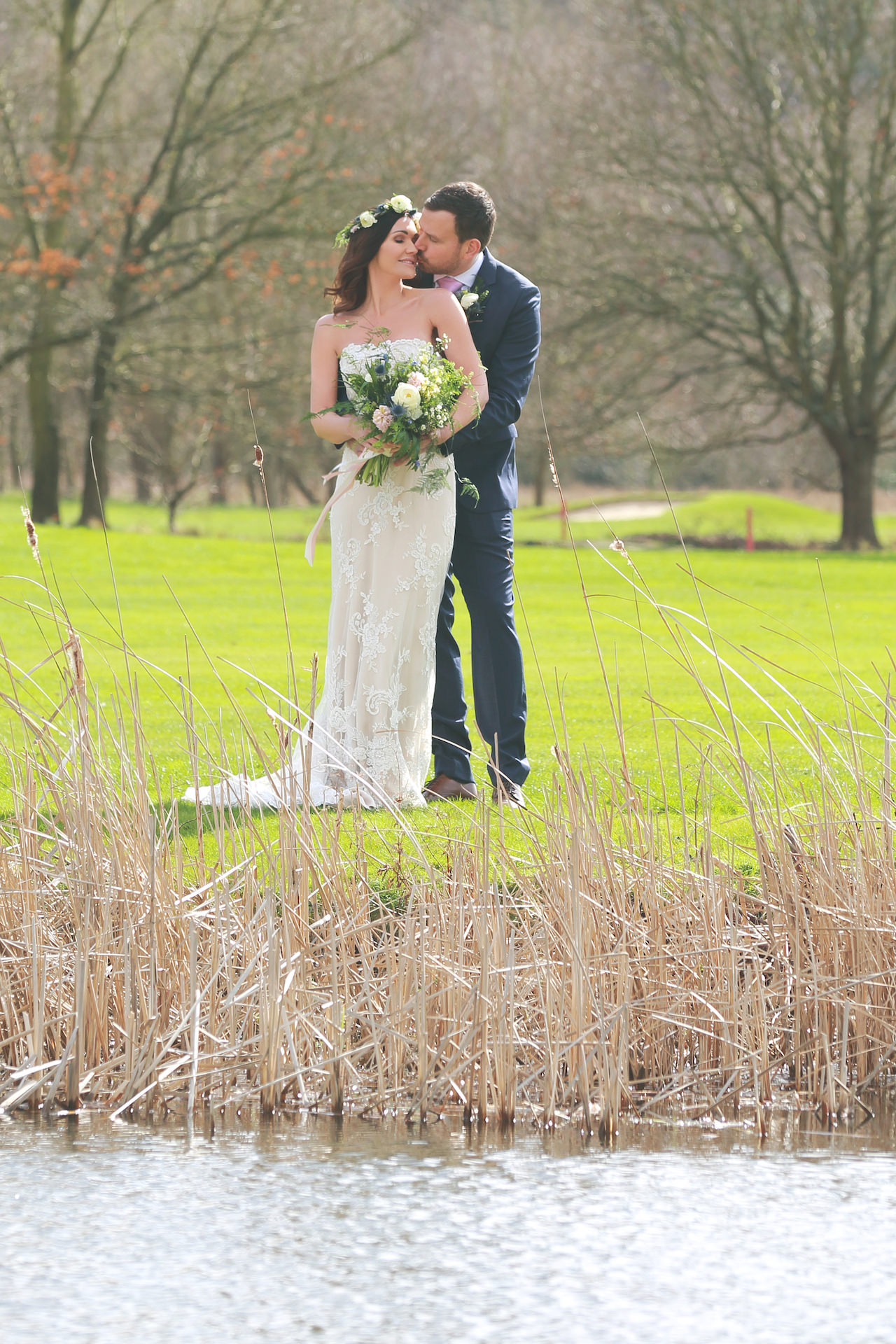 couple overlooking the pond at Burhill Golf Club