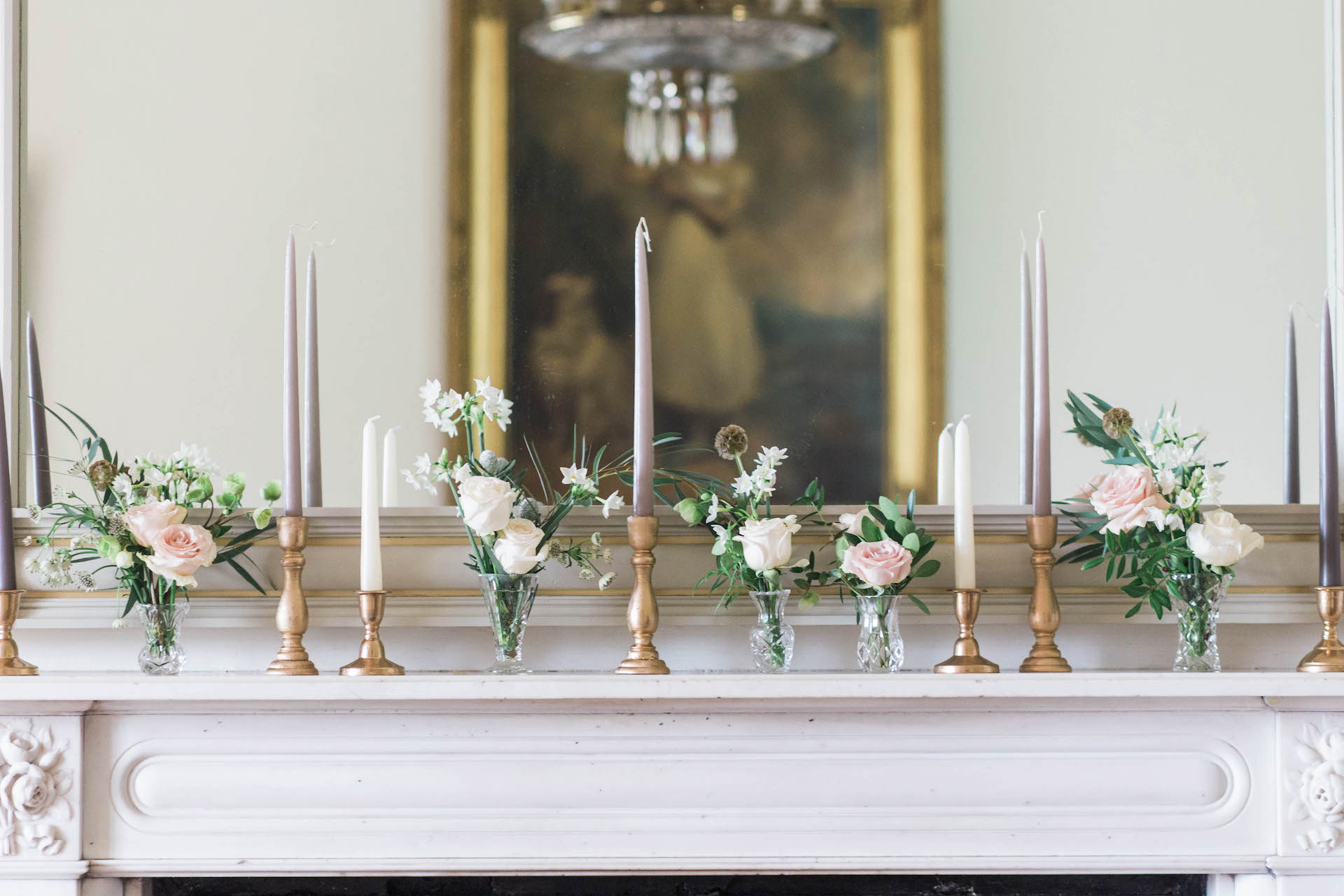 flowers and candles on mantlepiece at nurstead court