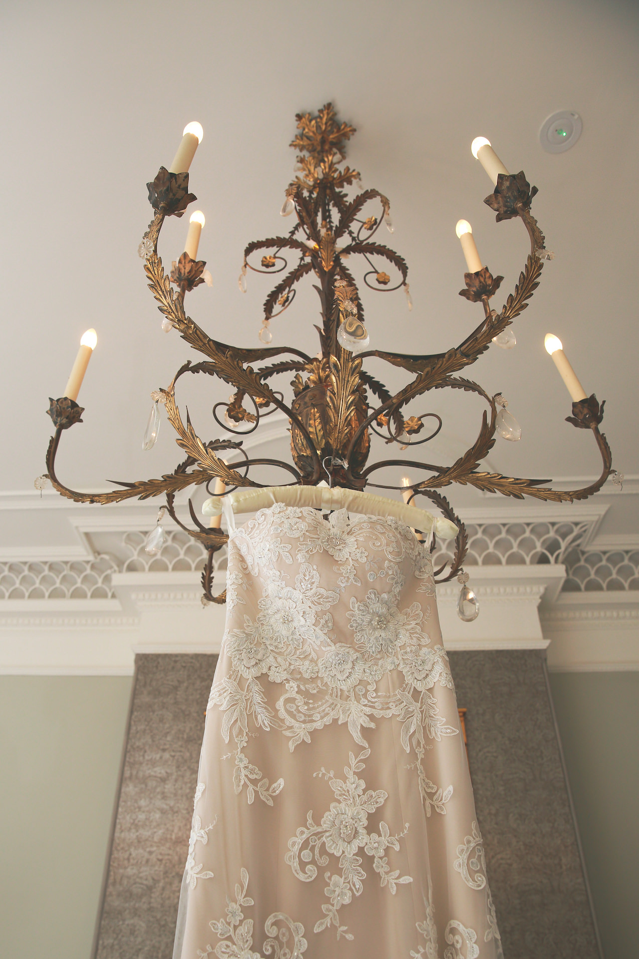 wedding dress hanging from chandelier at the Burhill Golf Club