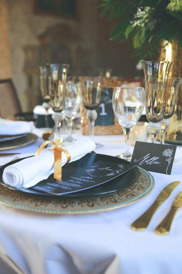 black and gold wedding tablescape at the elvetham hotel
