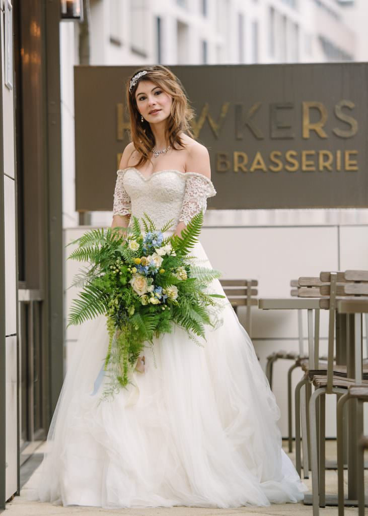 bride holding wedding bouquet outside hotel wedding venue surrey