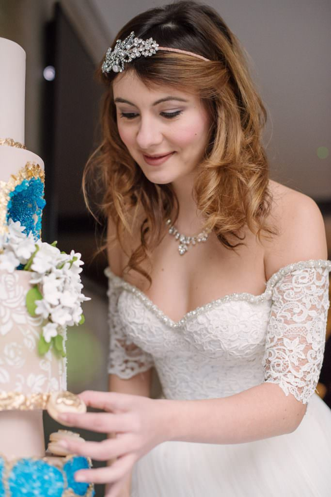 bride at wedding cake table at hotel wedding venues surrey