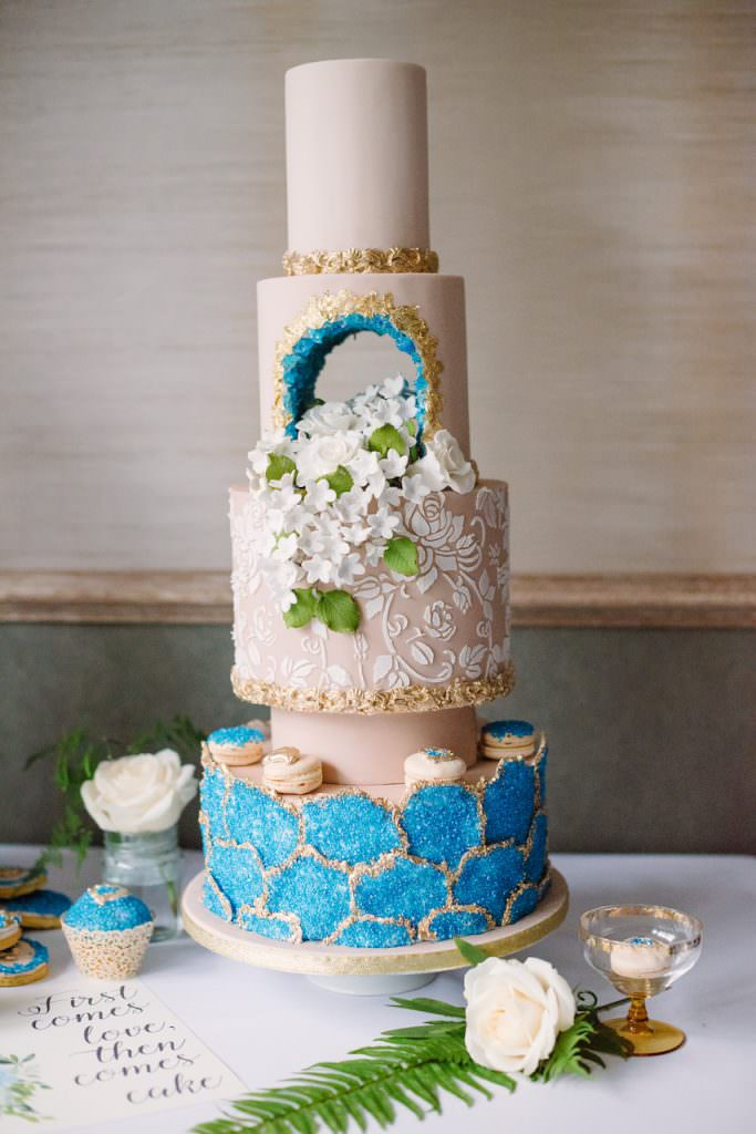 5 tier nude and teal blue wedding cake