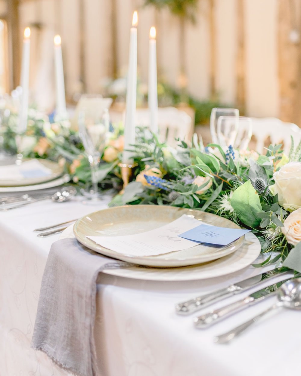 wedding table setting with floral runner