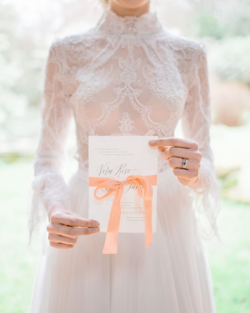 bride holding vow book on wedding day
