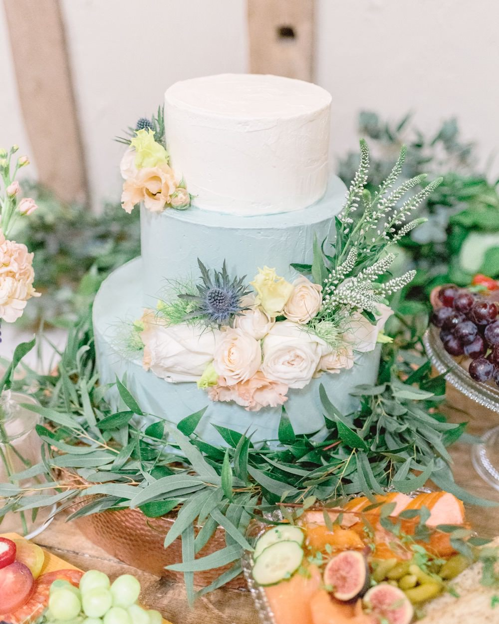 rustic blue and cream cake with foliage