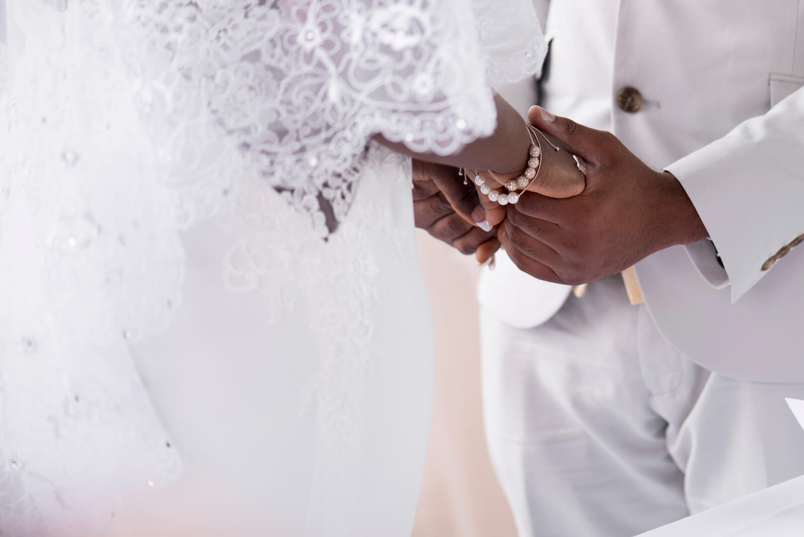black couple holding hands at wedding ceremony