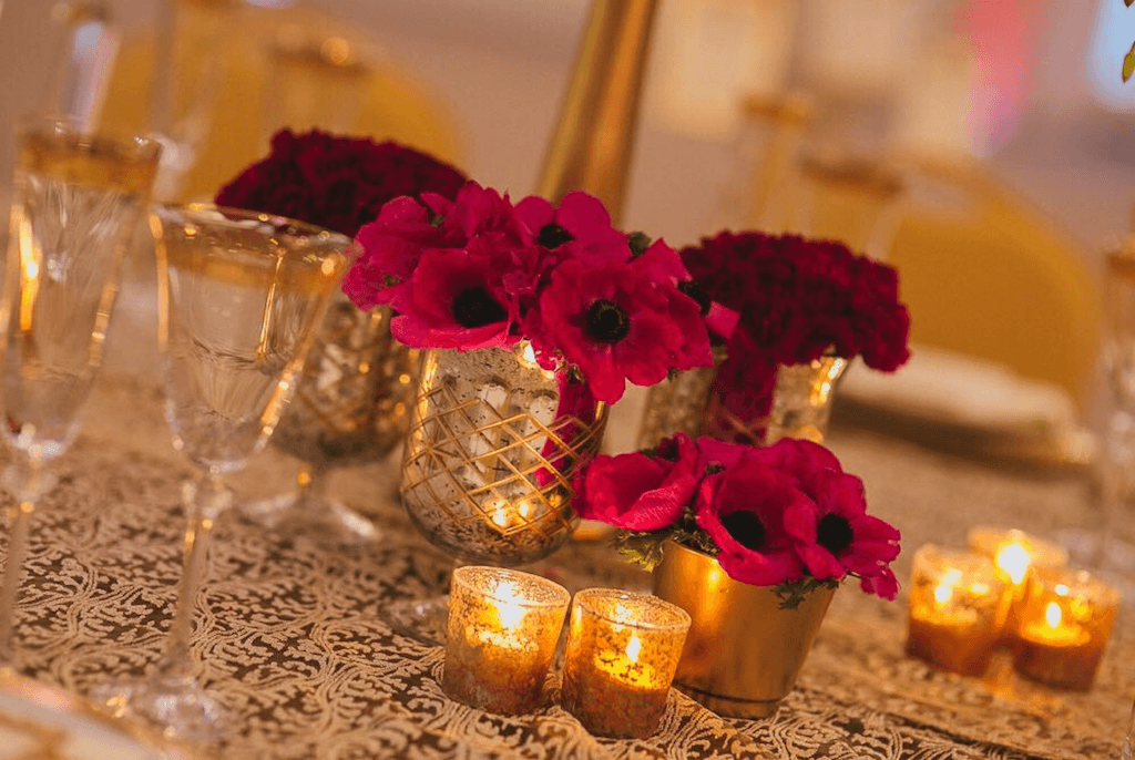 wedding design details with crimson flowers and gold details