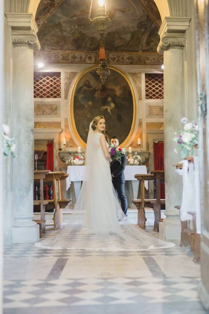 bride and groom at wedding ceremony at the private chapel of tuscany wedding venue