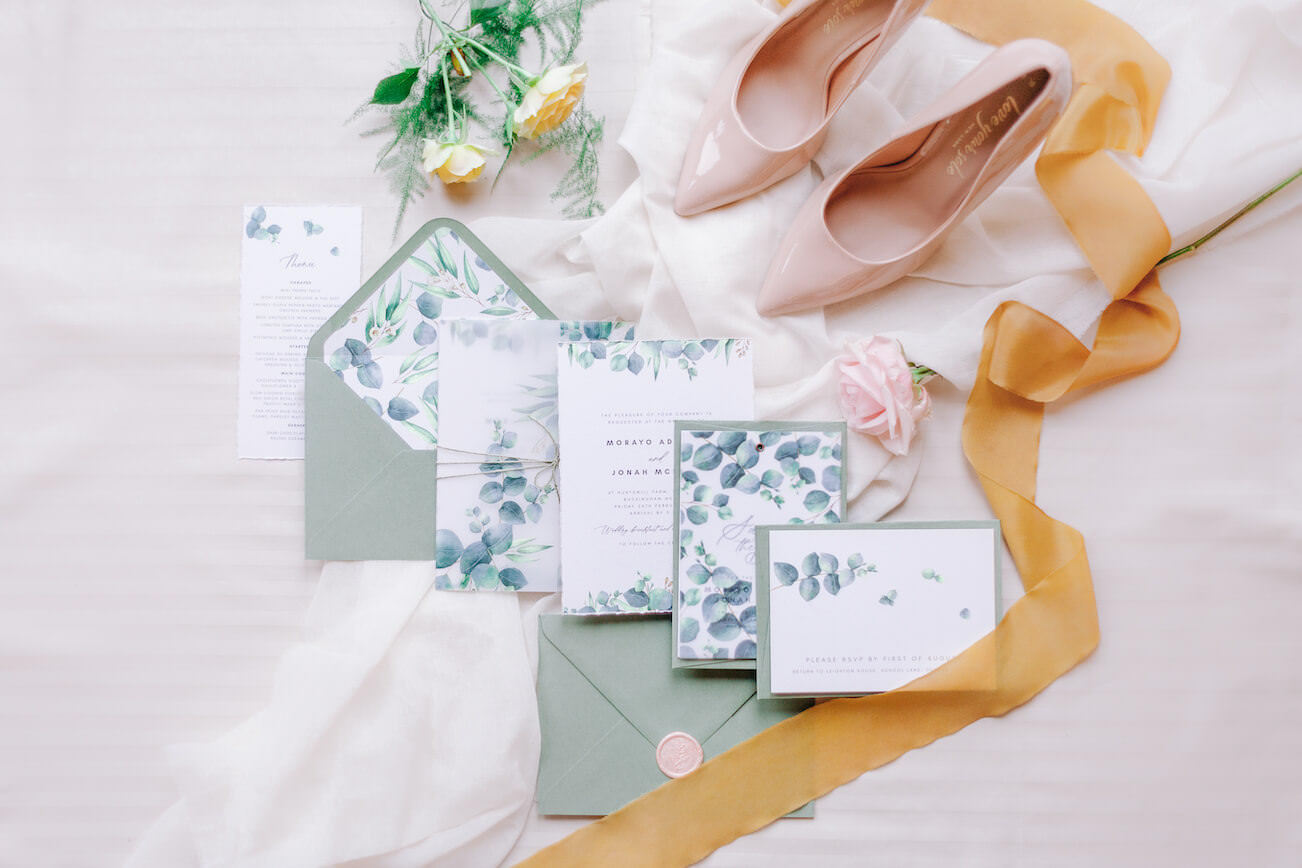 wedding stationery flatlay with shoes